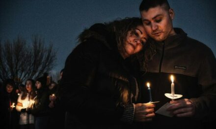 Candlelight vigil honors family slain on Christmas