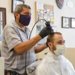 Barber struggles to keep doors open with state restrictions