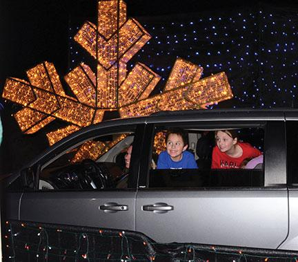 Local businesses, city light up the holidays